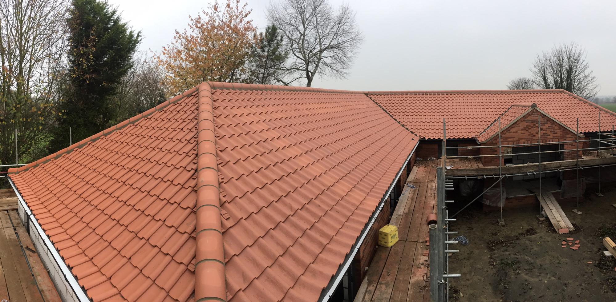 New tiled roof and ridge work